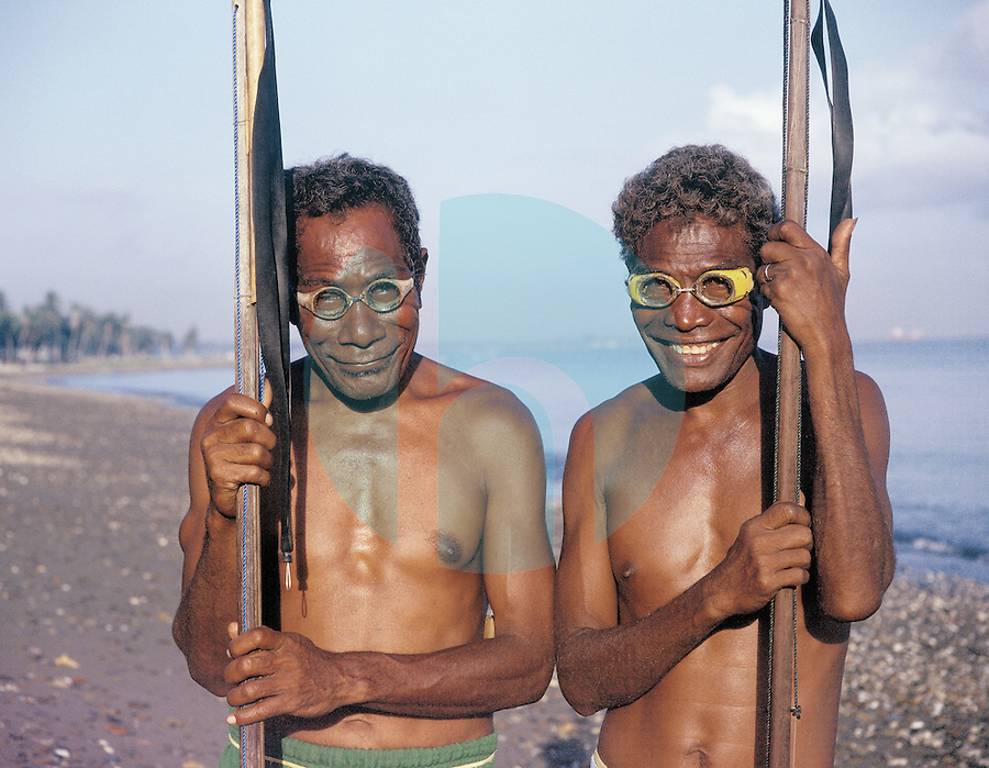 October 2nd, 2003-Dili, East Timor-Two spear fishermen from nearby Atauro Island in East Timor prepare to fish while standing on the beach near the capital of Dili. Fish is an important staple food of the Timorese diet & the people from Atauro Island, which is several Kilometers North of Dili, are famous seafarers.  Photograph by Daniel J. Groshong/Tayo Photo Group