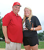Sarah Cornell, a junior at Clarke High School and standout pitcher on the varsity softball team, poses with her father, Daniel Cornell, on the softball field outside the school on Thursday, June 18, 2015.<br /> <br /> James Escher