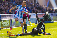 Huddersfield Town's midfielder Alex Pritchard (21) tackled by Crystal Palace's defender Mamadou Sakho (12) during the EPL - Premier League match between Huddersfield Town and Crystal Palace at the John Smith's Stadium, Huddersfield, England on 17 March 2018. Photo by Stephen Buckley / PRiME Media Images.