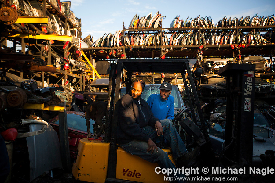 QUEENS, NY -- OCTOBER 22, 2013:  Barry and Yoni, owners of ACDC Scrap Metal Inc., sit on a fork lift in Willets Point on October 22, 2013 in Queens.  Photographer: Michael Nagle for The New York Times