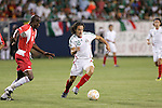 21 June 2007:  Mexico's Jose Andres Guardado (18) looks to dribble past Guadeloupe's Alain Vertot (6). The National Team of Mexico defeated Guadeloupe 1-0  in a CONCACAF Gold Cup Semifinal match at Soldier Field in Chicago, Illinois.