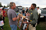 CCSO Dep. T.J. Boggan talks with Shawn McConnell at the SWAT booth at the 11th annual National Night Out hosted by the Carson City Sheriff's Office in Carson City, Nev., on Tuesday, Aug. 6, 2013. <br /> Photo by Cathleen Allison