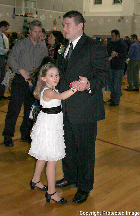 Emma Toole age 7 dances with her father Michael Toole, during the Snowflake Social Dance on Friday March. 3, 2012 at the Norwood Middle School in Norwood. The Snowflake Social was formerly called the Father/Daughter - Mother/Son Dance.(Photo by Gary Wilcox)