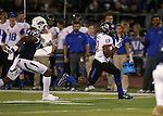 Nevada defender Bryan Lane Jr. (25) pursues Boise State's Jeremy McNichols (13) during the first half of an NCAA college football game in Reno, Nev., on Saturday, Oct. 4, 2014. Boise State won 51-46. (AP Photo/Cathleen Allison)