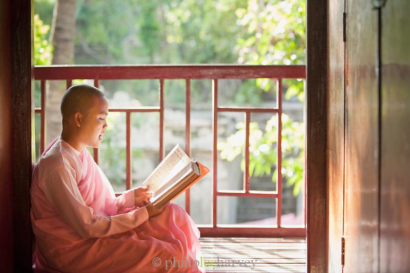 A young nun studies and prays at Zayar Theingi  convent in Sagaing, near Mandalay, Myanmar