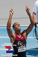 Florida State junior and Raytown South HS grad Maurice Mitchell points to the sky acknowledging God as he heads off the track after winning the 200 meter final at the 2011 NCAA Division I Outdoor Track & Field National Championships in Des Moines Iowa. It was Mitchell's first individual title and second overall after helping the Seminoles claim the 4x100 title about 40 minutes earlier.