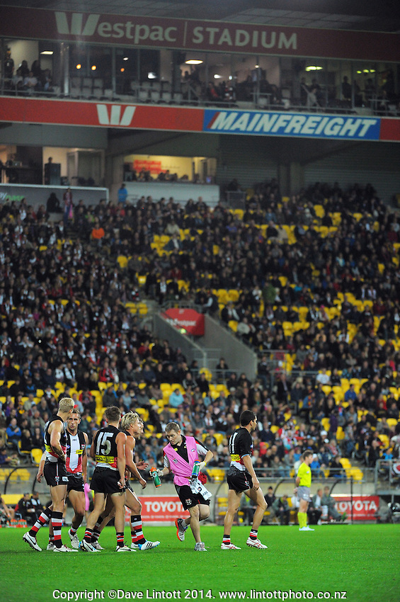 The Saints walk back to restart after scoring during the ANZAC Day AFL match between St Kilda Saints and Brisbane Lions at Westpac Stadium, Wellington, New Zealand on Friday, 25 April 2014. Photo: Dave Lintott / lintottphoto.co.nz