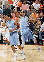 North Carolina forward J.P. Tokoto (13) grabs a rebound during an NCAA basketball game against Virginia Monday Jan. 20, 2014 in Charlottesville, VA. Virginia defeated North Carolina 76-61.