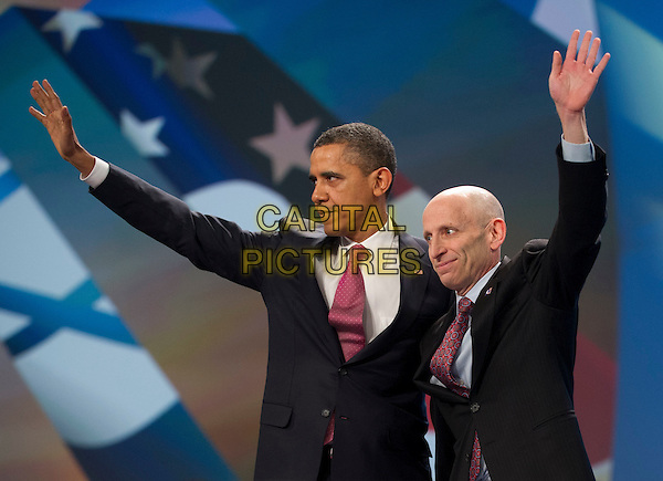 United States President Barack Obama and AIPAC President Lee Rosenberg of Chicago, Illinois wave to the 13,000 assembled delegates following Obama's remarks at the American Israel Public Affairs Committee (AIPAC) Policy Conference in Washington, D.C. on Sunday, March 4, 2012. .half length black suit jacket arm in air waving .CAP/ADM/CNP/RS.©Ron Sachs/CNP/AdMedia/Capital Pictures.