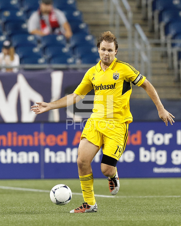 Columbus Crew defender Chad Marshall (14) brings the ball forward. In a Major League Soccer (MLS) match, the New England Revolution defeated Columbus Crew, 2-0, at Gillette Stadium on September 5, 2012.