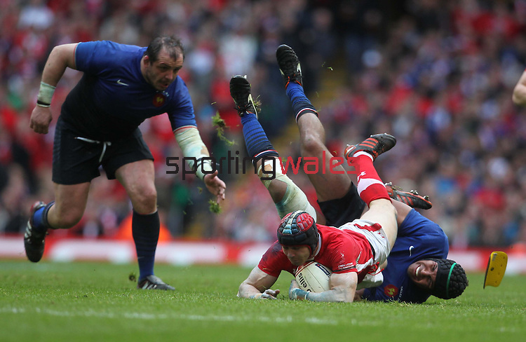 Thierry Dusautoir hauls down Leigh Halfpenny..RBS 6 Nations 2012.Wales v France.Millennium Stadium.17.03.12..CREDIT: STEVE POPE-SPORTINGWALES