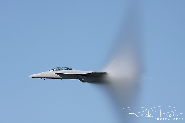 Water vapor covers the tail of an F/A-18 Hornet while executing a high speed pass during the 2010 San Francisco Fleet Week Air Show.