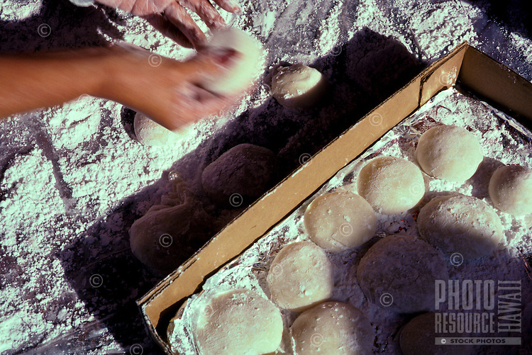 Woman forming mochi, a Japanese rice cake made from glutinous rice