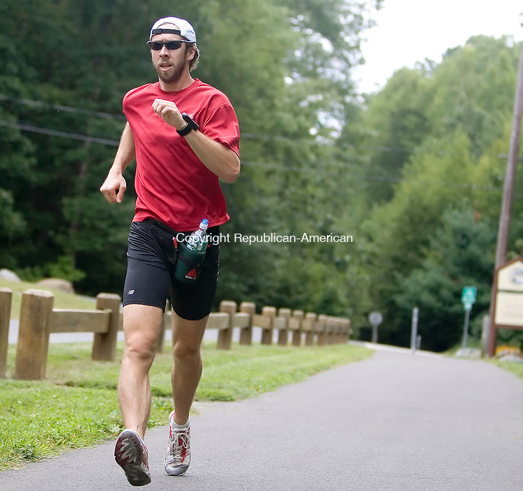 MIDDLEBURY, CT- 29 AUGUST 2008- 082908JT01-<br /> Theron Kissinger, a math teacher at Oxford High School, race walks on the Middlebury Greenway on Friday.<br /> Josalee Thrift / Republican-American