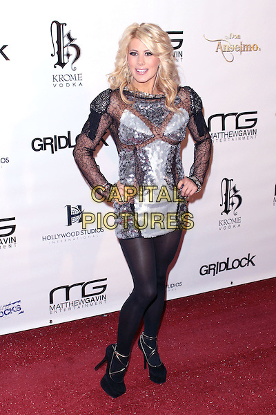 "SHAYNE LAMAS .""Gridlock New Year's Eve Bash"" held at Paramount Studios, Hollywood, California, USA,  31st December 2009..NYE full length black tights silver mini dress platform shoes see through lace sheer thru sequin sequined gold hands on hips .CAP/ADM/TC.©T. Conrad/AdMedia/Capital Pictures."