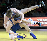 SIOUX FALLS, SD: DECEMBER 8: Brady Ayers from South Dakota State battles with Jeff Nielsen from Augustana in their 174 pound match Sunday afternoon at the Sanford Pentagon. (photo by Dave Eggen/Inertia)