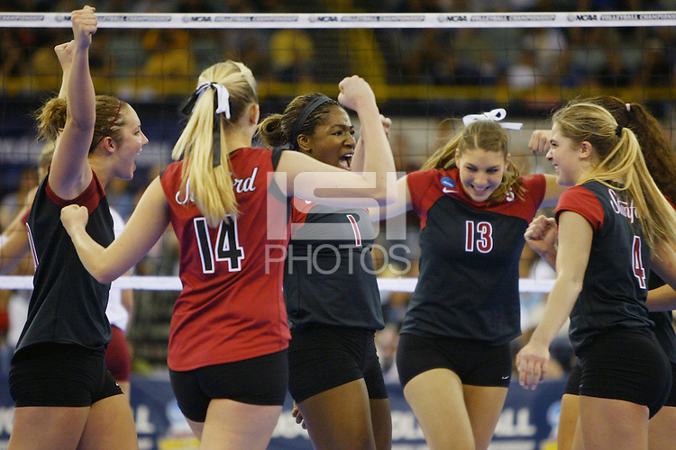 18 December 2004: Stanford Cardinal Ogonna Nnamani celebrates with Kristin Richards, Courtney Schultz, Liz Suiter, and Bryn Kehoe during Stanford's  30-23, 30-27, 30-21 victory over Minnesota in the 2004 NCAA Women's Volleyball National Championships in Long Beach, CA. Stanford won their sixth women's volleyball title in school history. Nnamani was named the tournament's Most Outstanding Player and broke the tournament record for kills.<br />