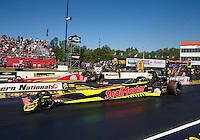 May 15, 2016; Commerce, GA, USA; NHRA top fuel driver J.R. Todd (near) races alongside teammate Doug Kalitta during the final round of the Southern Nationals at Atlanta Dragway. Mandatory Credit: Mark J. Rebilas-USA TODAY Sports