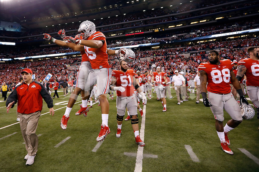 Ohio State players celebrate following their 59-0 win over the Wisconsin Badgers in the Big Ten Championship game at Lucas Oil Stadium in Indianapolis on Dec. 6, 2014. (Adam Cairns / The Columbus Dispatch)