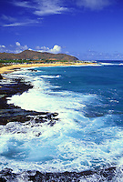 Oahu coastline of Sandy beach with white water crashing on rocks
