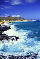 Oahu coastline of Sandy beach with white water crashing on rocks