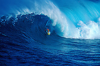 Surfer Mike Waltze surfing at Jaws on Maui