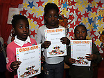 Mistura, Aisha and Uthman Yusuf pictured with their certificates for the Circus Stars summer reading project at the library. Photo: Colin Bell/pressphotos.ie