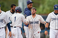 Charlotte Stone Crabs Connor Hollis (right) celebrates with teammates, including Wander Franco (1), after hitting a walk-off double during a Florida State League game against the Bradenton Maruaders on August 7, 2019 at Charlotte Sports Park in Port Charlotte, Florida.  Charlotte defeated Bradenton 3-2 in the second game of a doubleheader.  (Mike Janes/Four Seam Images)