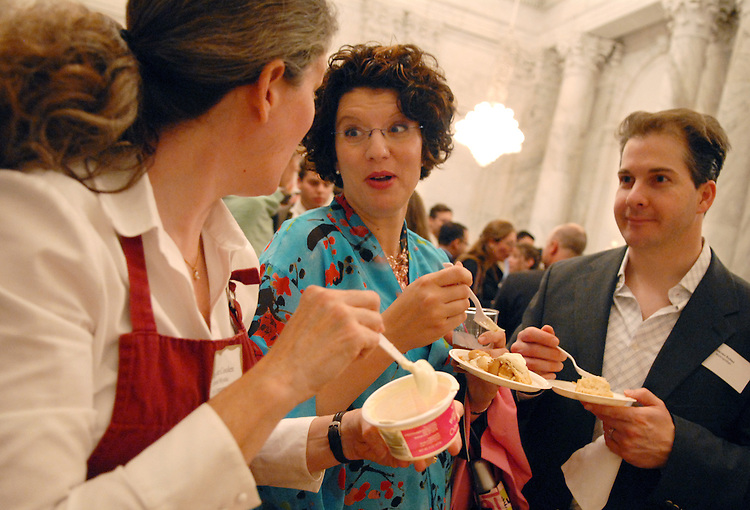 Shannon and Steven Kohan enjoy apple pie with Mary Jane Coolen, left, of Vermont Mystic Pie Company, at the Taste of Vermont Reception feature foods from Vermont, Wednesday in Russell Building.