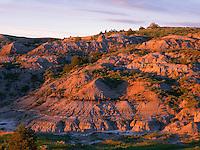 NDTR_104 - USA, North Dakota, Theodore Roosevelt National Park, Sunset light defines eroded sedimentary hillside near Boicourt Overlook in the South Unit.