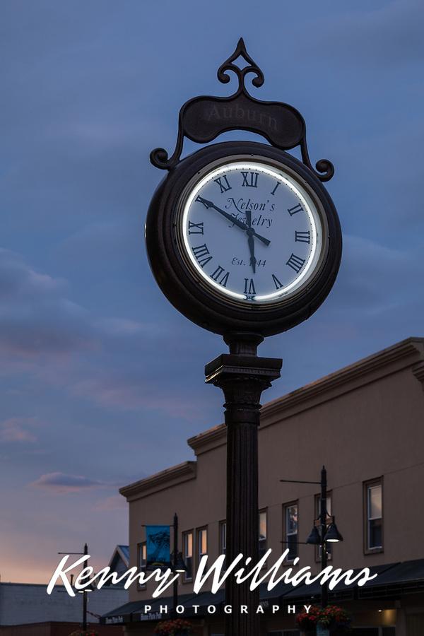 Large antique clock at dusk, Auburn, Washington State, USA.