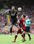 Liverpool's Roberto Firmino tussles with Crystal Palace's Ruben Loftus-Cheek during the premier league match at the Anfield Stadium, Liverpool. Picture date 19th August 2017. Picture credit should read: David Klein/Sportimage