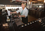 021711tvfishbartender.Catch-22 bartender Lindsay Garrett makes a Jack & Coke for a customer at the expansive bar inside the seafood eatery..BND/TIM VIZER   with Sue SunMag story
