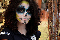 A woman is seen painted at Autonomous University of Mexico while they  celebrate the day of the dead in honor  to the 50 anniversary of the death of the Spanish-Mexican surrealist painter Remedios Varo, October 25, 2013. Photo by Miguel Angel Pantaleon/VIEWpress