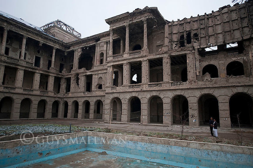 "Darul Aman Palace (""abode of peace"" or, in a double meaning ""abode of Aman[ullah]"")[1] is a European-style palace, now ruined, located about sixteen kilometers (ten miles) outside of the center of Kabul, Afghanistan.Darul Aman Palace was built in the early 1920s as a part of the endeavours by King Amanullah Khan to modernize Afghanistan. It was to be part of the new capital city (also called Darul Aman or Darulaman) that the king was intending to build, connected to Kabul through a narrow-gauge railway. [2] The palace is an imposing neoclassical building on a hilltop overlooking a flat, dusty valley in the western part of the Afghan capital. Intended as the seat for a future parliament outside of Kabul, the building was unused for many years after religious conservatives forced Amanullah from power and halted his reforms. Darul Aman Palace was first gutted by fire in 1969. It was restored to house the Defence Ministry during the 1970s and 1980s. During the Communist coup of 1978, the building was set on fire. It was damaged again as rival Mujahideen factions fought for control of Kabul during the early 1990s. Heavy shelling by the Mujahideen after the end of the Soviet invasion left the building a gutted ruin."