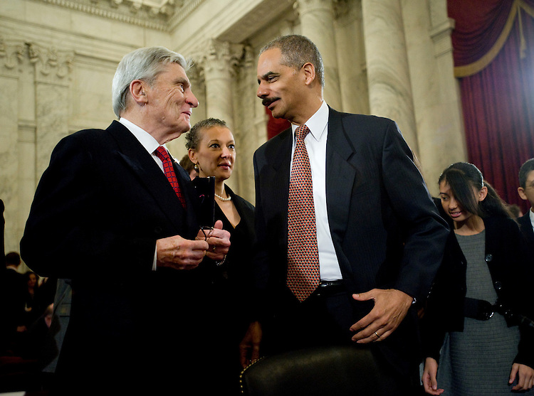 "WASHINGTON, DC - Jan. 15: Former Sen. John Warner, R-Va., and Attorney General-designate Eric H. Holder Jr. during a break in Holder's nomination hearing before Senate Judiciary. Warner introduced Holder. Holder outlined positions on detainee treatment and presidential authority that starkly differ from those of the Bush administration. In response to the first question, from committee Chairman Patrick J. Leahy, D-Vt., Holder said flatly that the simulated drowning technique of interrogation known as ""waterboarding"" is torture. (Photo by Scott J. Ferrell/Congressional Quarterly)"