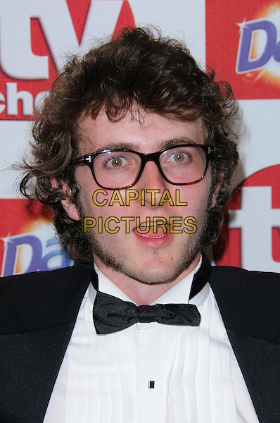 Tom Scurr.Arrivals at the TV Choice Awards 2012 held at the Dorchester Hotel, London, England..September 10th, 2012.headshot portrait white shirt black bow glasses sideburns mouth open tie .CAP/CJ.©Chris Joseph/Capital Pictures.