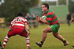 Ra Garmonsway looks to push off the upcoming tackle by Raymond Isara. Counties Manukau Premier Club Rugby game between Waiuku & Karaka played at Waiuku on Saturday July 4th 2009. Waiuku won the game 22 - 7.