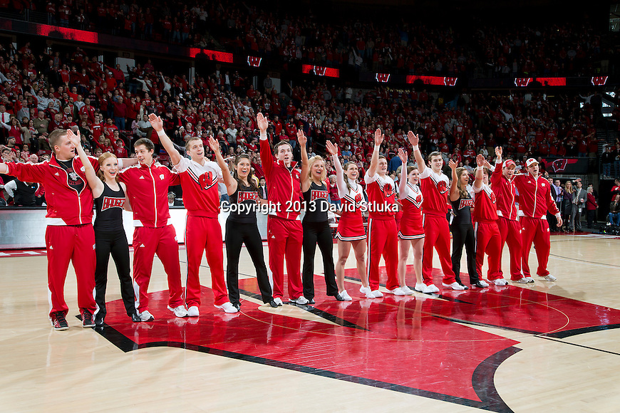 """Wisconsin Badgers senior spirit squad members sing """"Varsity"""" during a Big Ten Conference NCAA college basketball game against the Purdue Boilermakers Sunday, March 3, 2013, in Madison, Wis. Purdue won 69-56. (Photo by David Stluka)"""