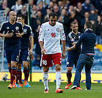 A Scotland fan joins in the celebrations after the first goal and shakes the hand of Shaun Maloney