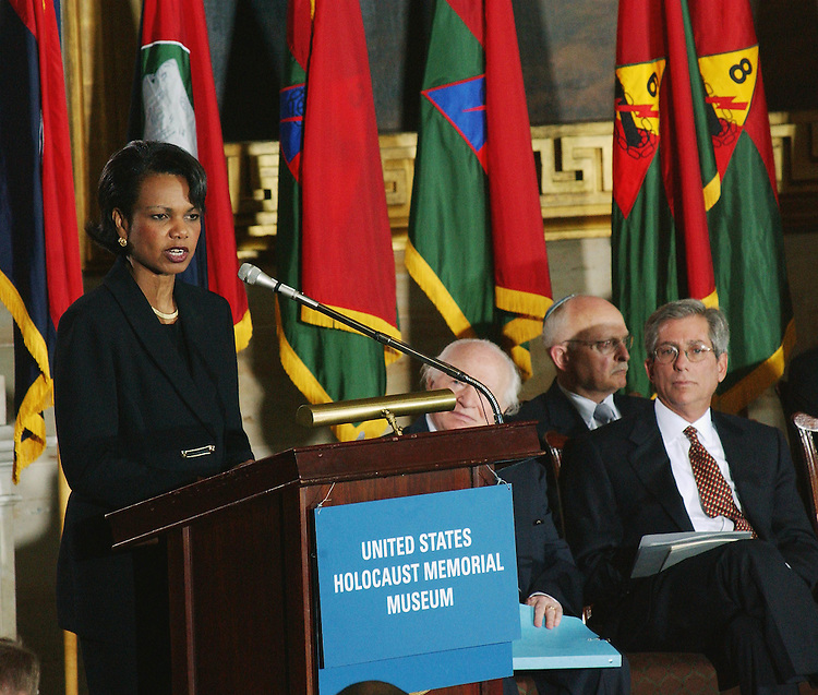 4/9/02.HOLOCAUST: NATIONAL COMMEMORATION OF THE DAYS OF REMEMBRANCE 2002--Condoleezza Rice, Assistant to the President for National Security Affairs, delivers the keynote address during the ceremony in the rotunda of the U.S. Capitol commemorating the holocaust. Behind her are flags representing each of the U.S. divisions which liberated each holocaust death camp..CONGRESSIONAL QUARTERLY PHOTO BY SCOTT J. FERRELL