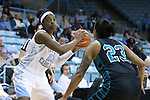 21 November 2013: North Carolina's Diamond DeShields (left) and Coastal Carolina's Kayla Cook (right). The University of North Carolina Tar Heels played the Coastal Carolina University Chanticleers in an NCAA Division I women's basketball game at Carmichael Arena in Chapel Hill, North Carolina. UNC won the game 106-52.