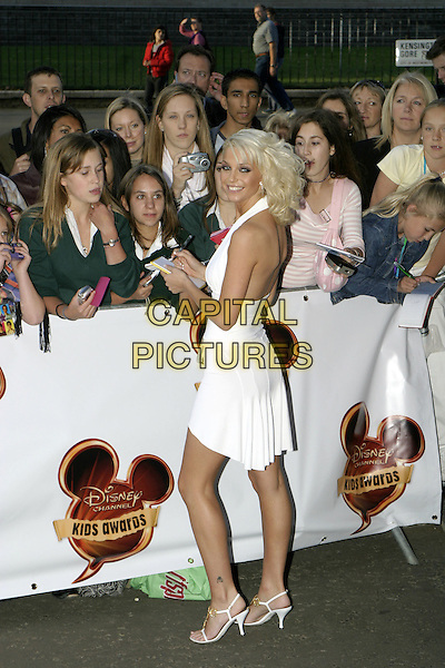 GIRLS ALOUD - SARAH HARDING.Disney Channel Kids Awards at the Royal Albert Hall.September 17th, 2004.full length, fans, crowd, signing autographs, white haltereck dress, tattoo on ankle.www.capitalpictures.com.sales@capitalpictures.com.© Capital Pictures.