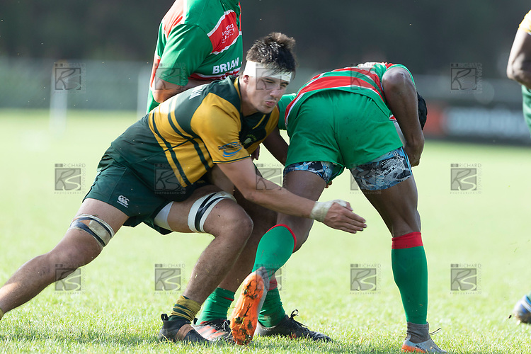 James Orr playing his first game for the Premiers looks to stop Vuga Tagicakibau. Counties Manukau Premier Club rugby game between Pukekohe and Waiuku, played at Colin Lawrie Fields, Pukekohe on Saturday April 14th, 2018. Pukekohe won the game 35 - 19 after leading 9 - 7 at halftime.<br /> Pukekohe Mitre 10 Mega -Joshua Baverstock, Sione Fifita 3 tries, Cody White 3 conversions, Cody White 3 penalties.<br /> Waiuku Brian James Contracting - Lemeki Tulele, Nathan Millar, Tevta Halafihi tries,  Christian Walker 2 conversions.<br /> Photo by Richard Spranger