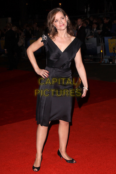 """ANNE-MARIE DUFF .The closing gala premiere of """"Nowhere Boy"""" during the The Times BFI London Film Festival, Odeon Leicester Square, London, England..October 29th, 2009 .LFF full length black dress hand on hip wrap brooch clutch bag .CAP/AH.©Adam Houghton/Capital Pictures."""