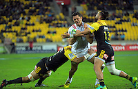 Ardie Savea and Matt Proctor tackle Anton Lienert-Brown during the Super Rugby semifinal match between the Hurricanes and Chiefs at Westpac Stadium, Wellington, New Zealand on Saturday, 30 July 2016. Photo: Dave Lintott / lintottphoto.co.nz