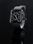 Shiny steel Apple Watch series 2 smartwatch with analog clock dial on display isolated on black background
