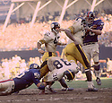 New York Giant Tommy Crutcher (56)  face masks two players from the Pittsburgh Steelers at the same time during a game on October 12,1969 at Yankee Stadium in the Bronx, New York.  The New York Giant beat the Pittsburgh Steelers 10-7. Tommy Crutcherr played for 8 season with 2 different teams.(SportPics)