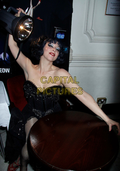 Meow Meow.Inside at the Opening night of 'Meow Meow In Concert' at the Apollo Theatre, Shaftesbury Avenue, London, England, UK, June 23rd 2011..half length 3/4 sitting at table light strapless black corset bustier .CAP/COA/CC.©CC/COA/Capital .
