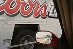 Coors Light panel truck from car window.